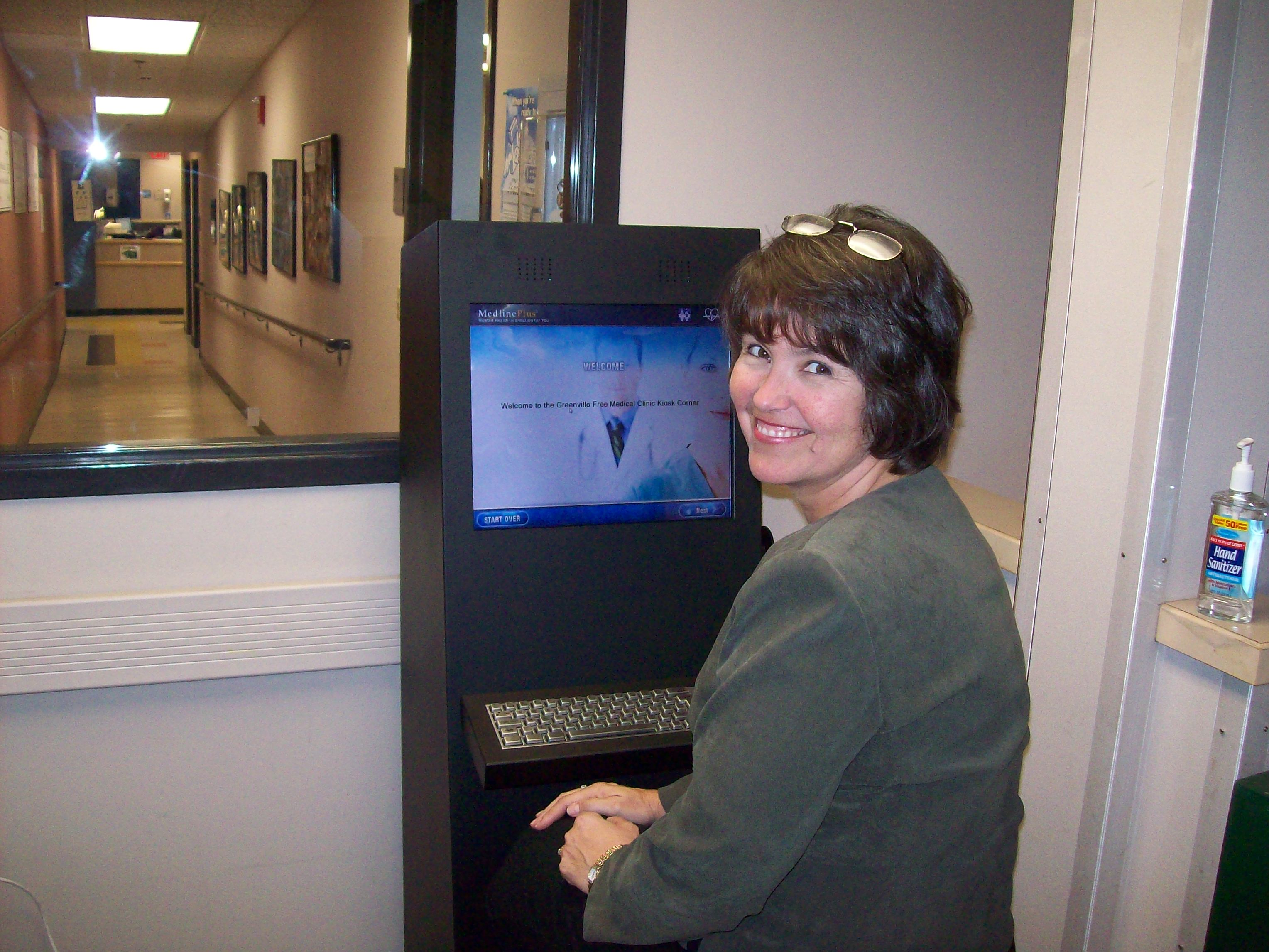 Suzie Foley using the kiosk at the Greenville Free Medical Clinic