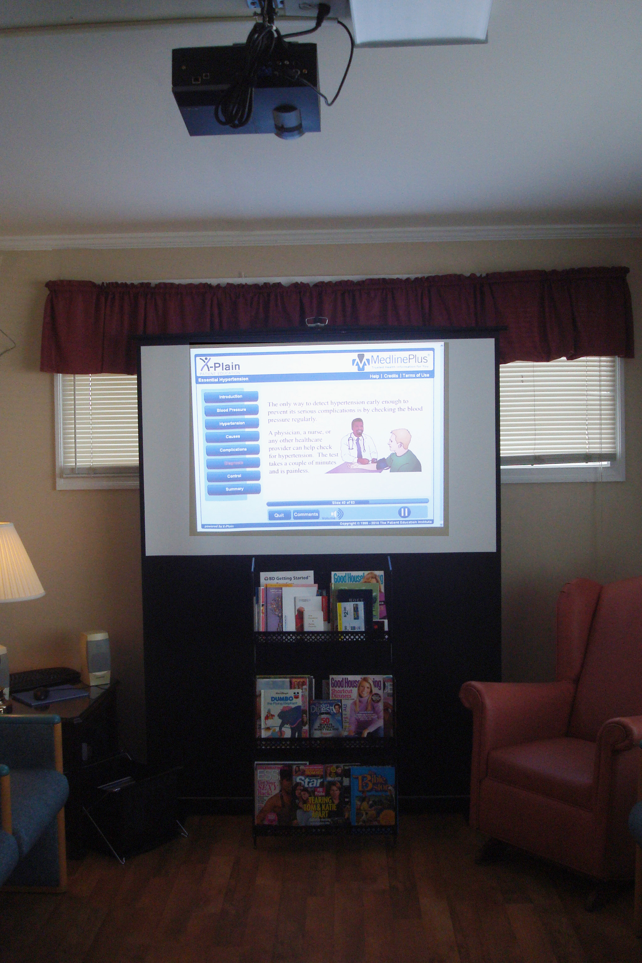 Projector and screen setup in Orangeburg waiting room